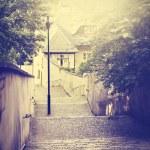 Retro vintage filtered old narrow street in Prague. — Stock Photo #78043894