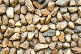 Stone wall  Texture of different forms stones similar to wall — Stock Photo