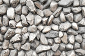 Stone wall. Texture of different forms stones similar to wall. — Stock Photo