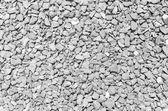 Pebble black white stones background closeup of stones texture   — Stock Photo