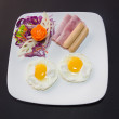 Plate of breakfast with fried eggs, bacon and toasts isolated ba — Stock Photo #59738389