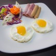 Plate of breakfast with fried eggs, bacon and toasts isolated ba — Stock Photo #59738455