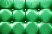 Closeup texture of vintage green leather sofa for background — Foto de Stock