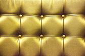 Struttura del primo piano del divano di pelle vintage oro per sfondo — Foto Stock