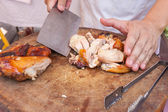 Chef are using Kitchen knife chicken grilled on wood block — Stock Photo