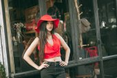 Beautiful girl is posing with red suit — Foto de Stock