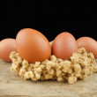Fresh brown eggs on wood background — Stock Photo #80171900