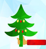 Christmas tree in hand — Stock Vector