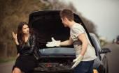 Couple near a broken car on the roadside — Stock Photo