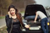 Failure on the road. Woman calls emergency services. — Stock Photo