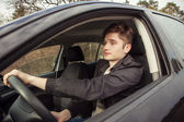 The young man behind the wheel,  traveling — Stock Photo