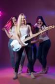 Music female artist, 4 beautiful girls, style, jeans, youth — Stock Photo