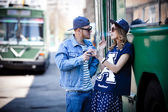 Stylish couple with drinks near transport, bus, retro — Stock Photo