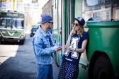 Stylish couple with drinks near transport, bus, retro — Stock Photo