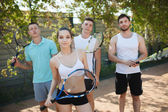 Posing for paddle tennis match in court — Stock Photo