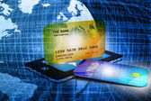 Mobile smart phone with credit card — Stock Photo