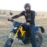 Rider on sport bike for enduro on motocross track — Stock Photo #53876467
