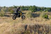 Rider on sport bike for enduro on motocross track — Stock Photo
