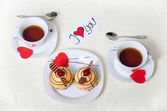 Valentines day, mouthwatering cakes on a plate, a declaration of — Stock Photo