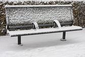 Snow covered empty bench — Stock Photo