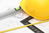 Helmet and tools for construction drawings and buildings — Stock fotografie