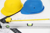 Helmets and tools for construction drawings and buildings — Stock Photo
