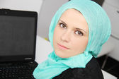 Beautiful young muslim business woman with laptop in office — Foto de Stock