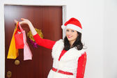 Beautiful and sexy woman wearing santa clause costume and waitin — Stock Photo