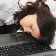 Tired business woman fell asleep next to a laptop — Stock Photo #58523241