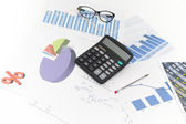 Businessman analyzing investment charts with calculator and lapt — Stock Photo