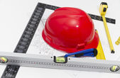 Helmet and tools for construction drawings and buildings — Foto de Stock