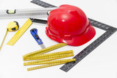 Helmet and tools for construction drawings and buildings — Stock Photo