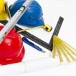 Colorful helmets and tools for construction drawings and buildin — Stock Photo #67177687