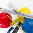 Colorful helmets and tools for construction drawings and buildin — Stock Photo #67178291
