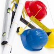 Colorful helmets and tools for construction drawings and buildin — Stock Photo #67181787