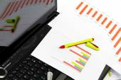 Analyzing business investment charts with calculator and laptop — Stock Photo