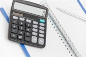 Business concept with calculator, pen and notebook — Stock Photo