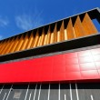 Colorful aluminum facade on large shopping mall — Stock Photo #65954937