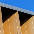 Colorful aluminum facade on large shopping mall — Stock Photo #65954999
