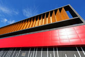 Colorful aluminum facade on large shopping mall — Stock Photo