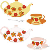 Vector set of teapots and cups decorated with flowers. Vector isolated objects. — Stock Vector