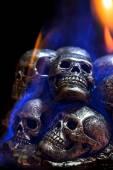 Burning skulls on black background  — Stockfoto