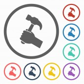 Hammer in hand icon — Stock Vector