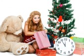 Smiling christmas woman near tree — Stockfoto