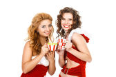 Two beautiful christmas girls isolated white background with tea pairs — Stock Photo