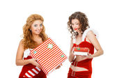 Two beautiful christmas girls isolated white background holding gifts — Stock Photo