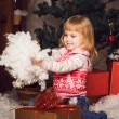 Little girl holding snow in christmas decoration — Stock Photo #58366987
