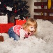 Little girl holding snow in christmas decoration — Stock Photo #58367001