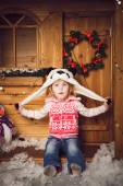 Little girl in panda hat with christmas decoration — Foto de Stock