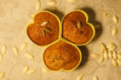 Homemade pumpkin muffins in the shape of heart — Stock Photo
